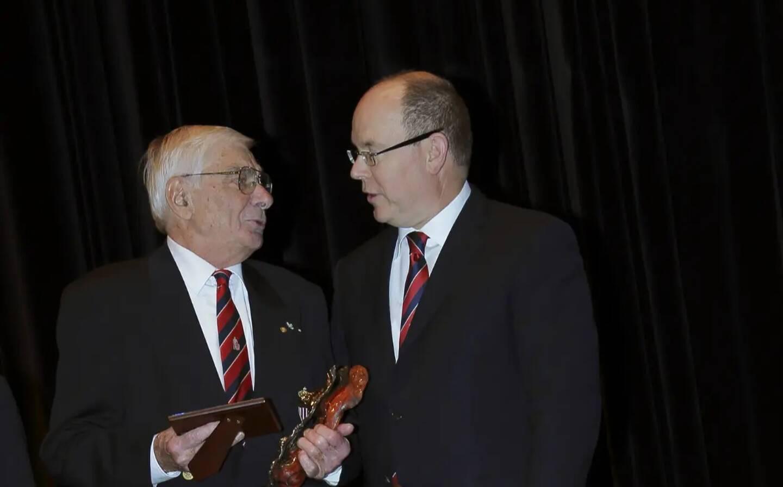 Robert Enrietti lors de la soirée des 90 ans du club de l'ASM, avec le prince Albert II à ses côtés.