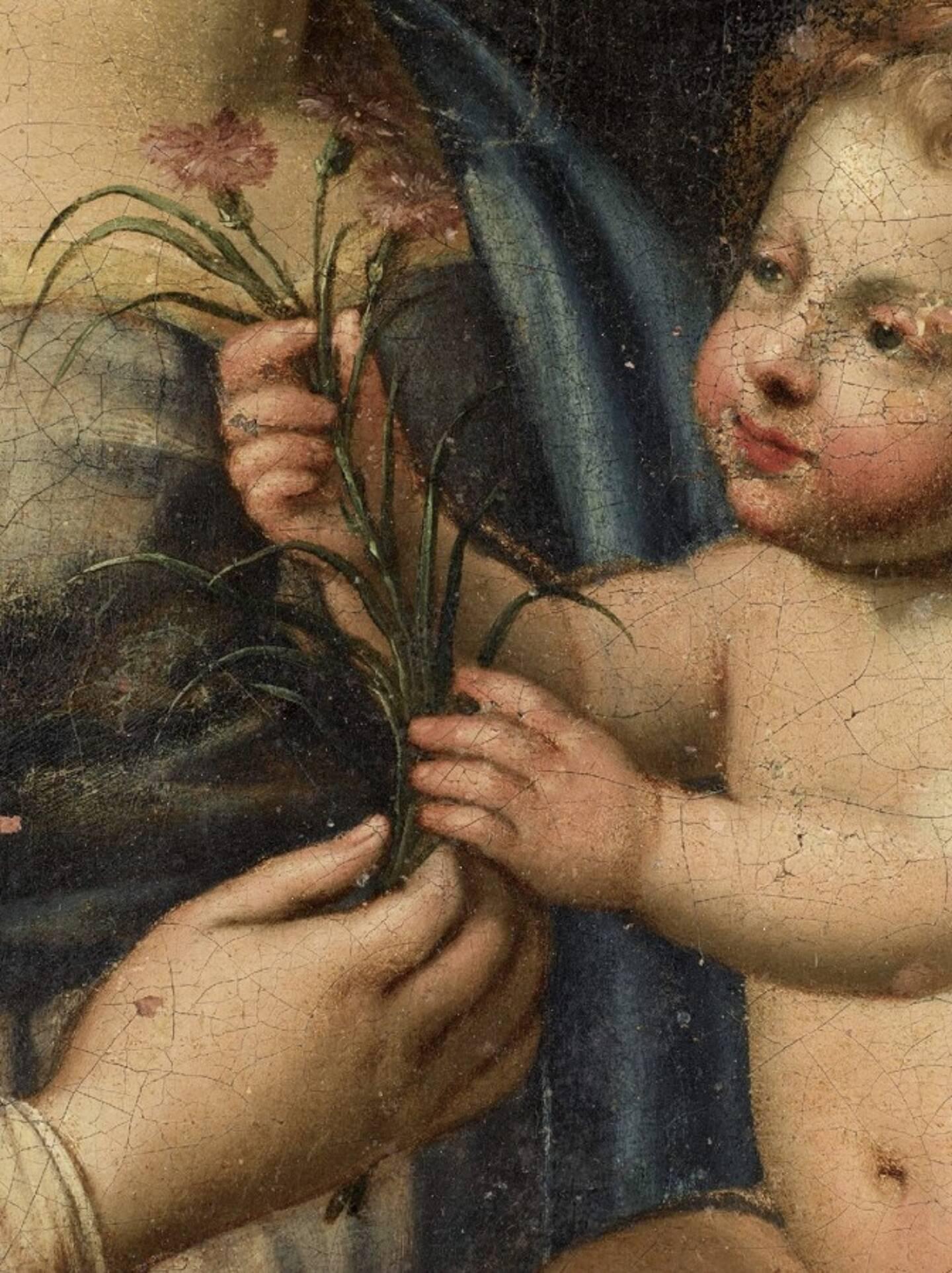 Un détail de la scène qui illustre la complicité entre la vierge et l'enfant Jésus.
