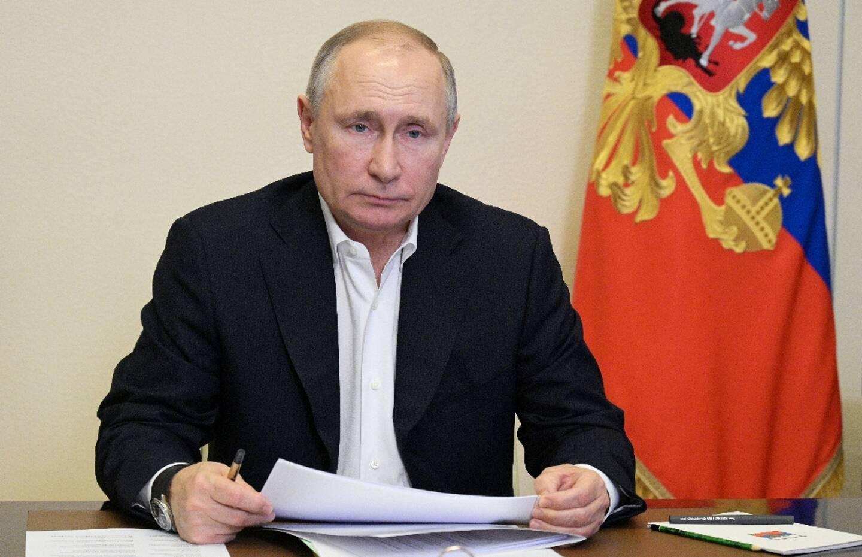 Le président russe Vladimir Poutine lors d'une visio-conférence près de Moscou le 19 avril 2021