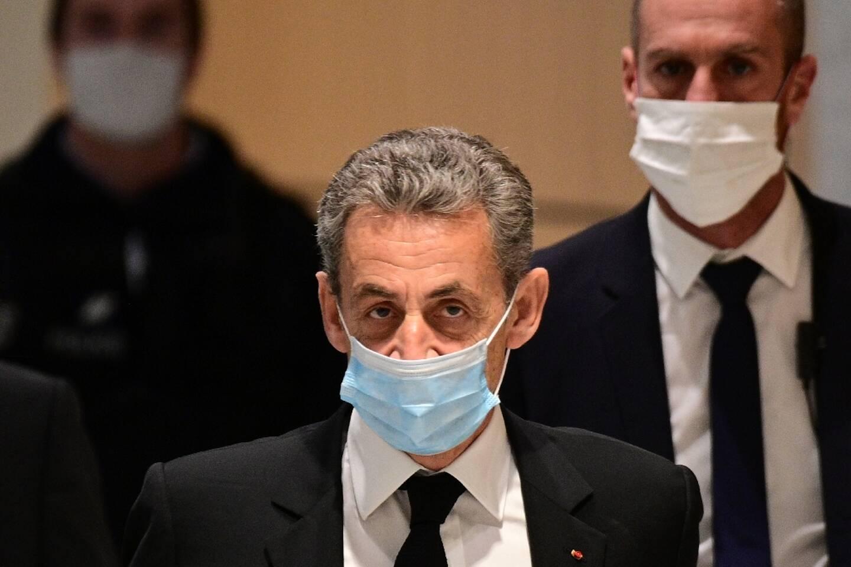 """L'ancien président Nicolas Sarkozy arrive le 7 décembre 2020 au tribunal de Paris lors du procès dit """"des écoutes"""""""