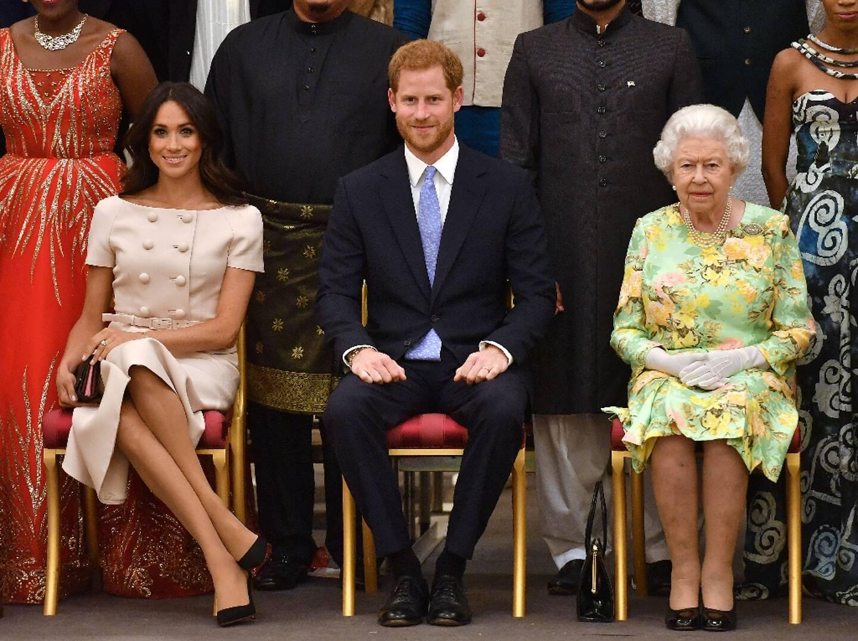 Meghan Markle, le prince Harry et la reine Elizabeth II à Bunckingham Palace, en juin 2018