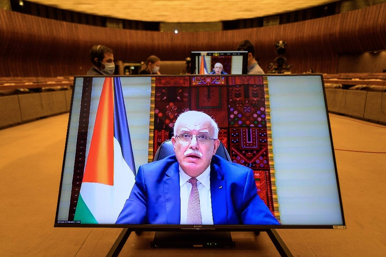 Le ministre des Affaires étrangères palestinien Riyad al-Maliki prononce à distance un discours lors d'une réunion du Conseil des droits de l'homme de l?ONU, à Genève, le 27 mai 2021