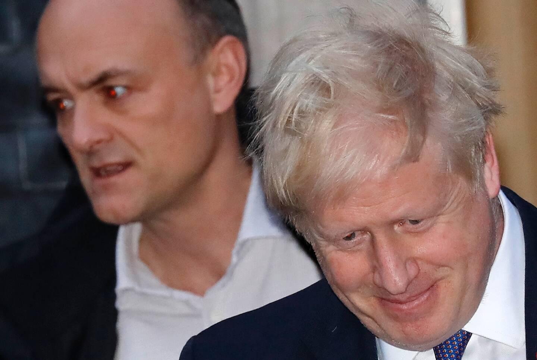 Le Premier ministre britannique Boris Johnson et son ancien conseiller Dominc Cummings le 28 octobre 2019 quittant Downing Street, le siège du gouvernement