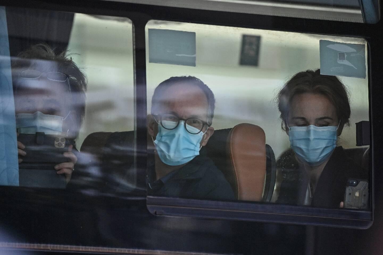 Des membres de l'équipe de l'OMS chargée d'enquêter sur les origines de la pandémie de Covid-19, à Wuhan (Chine) le 28 janvier 2021.