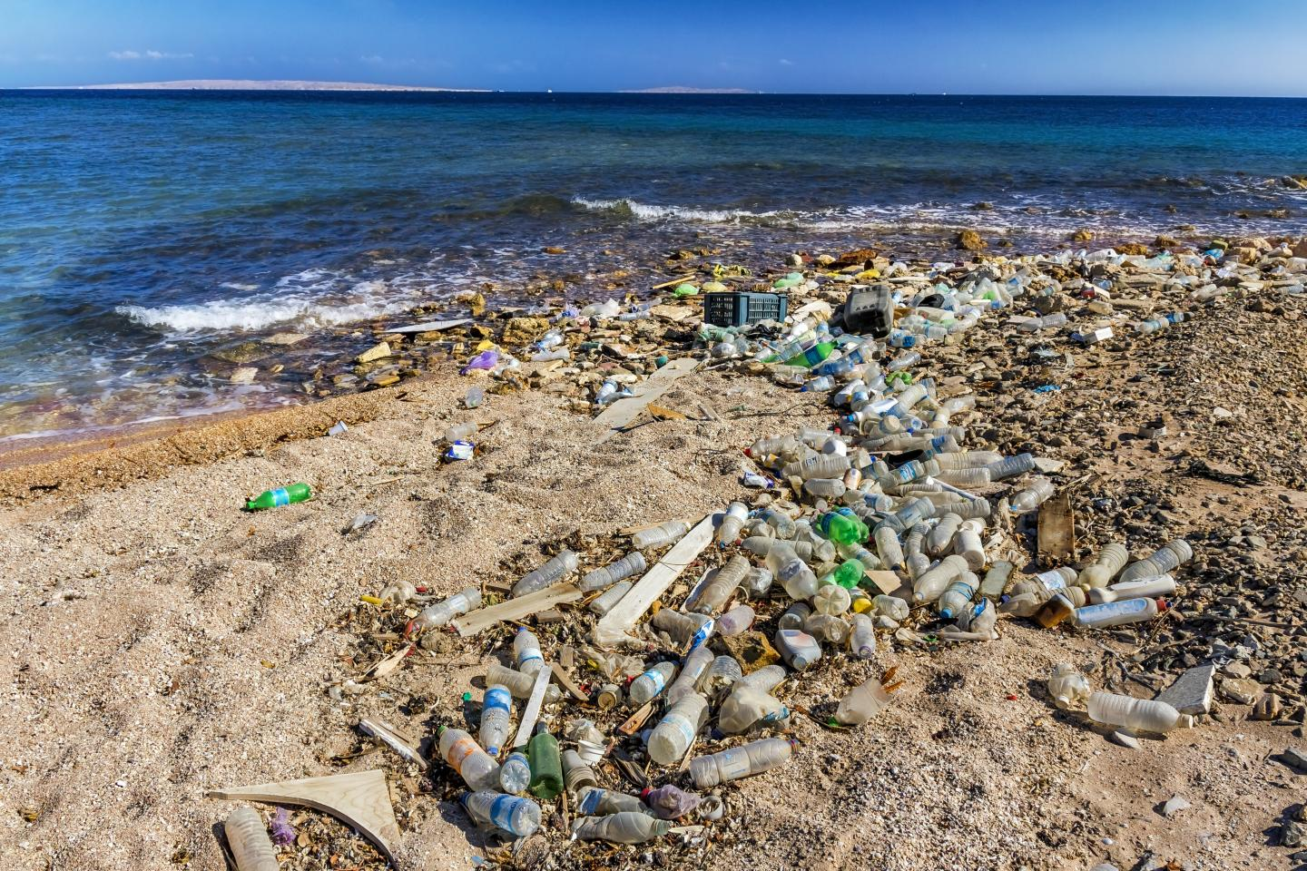 Garbage in the Beach and beautiful seascape in background, Egypt, Red Sea