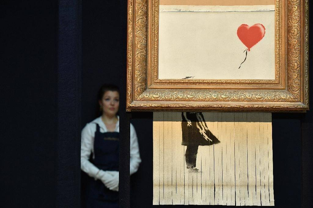 """""""Love is in the Bin"""", une ?uvre qui a été créée lorsque le tableau """"Girl with Balloon"""" a été passée dans une déchiqueteuse lors d'une intervention surprise de Bansky, aux enchères de Sotheby's, à Londres le 12 octobre 2018"""