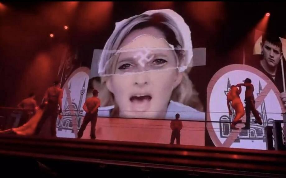 Le clip de la chanteuse : croix nazie sur le front de Marine Le Pen ou svastika indien sur celui de Madonna ?(Repro N.M.)