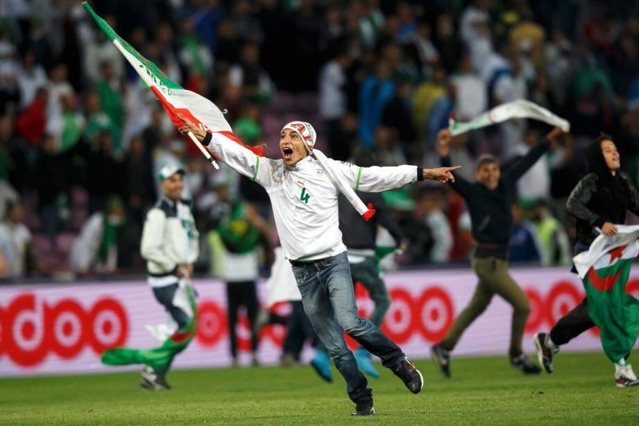 Les supporters des Fennecs, ici à Genève après la victoire de l'Algérie sur la Roumanie (2-1) le 4 juin dernier, se réjouissent de la quatrième qualification de l'Algérie à une coupe du monde.