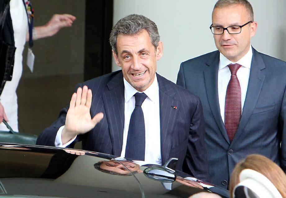 Nicolas Sarkozy, mercredi, à l'arrivée de sa conférence à l'hôtel Fairmont à Monaco.