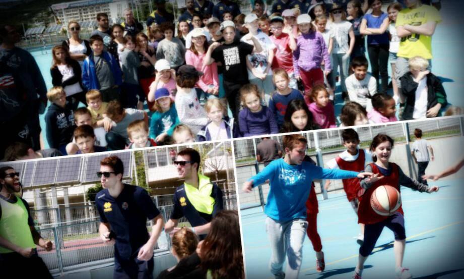 Les enfants des centres de loisirs avec les joueurs du HTVB au complexe sportif Léo Lagrange.