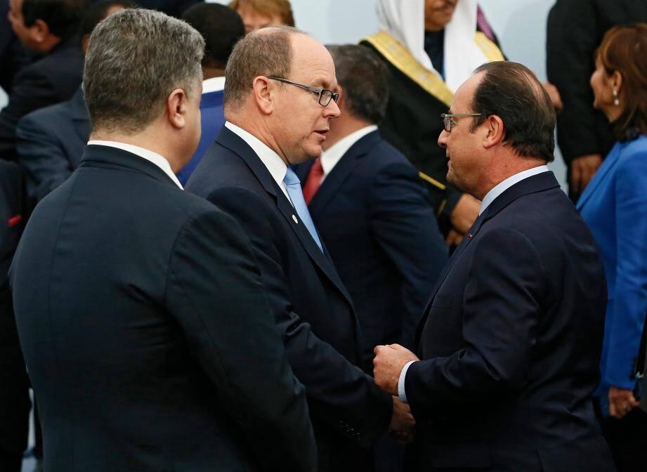 Le prince Albert II ici aux côtés du président François Hollande lors de la COP21.