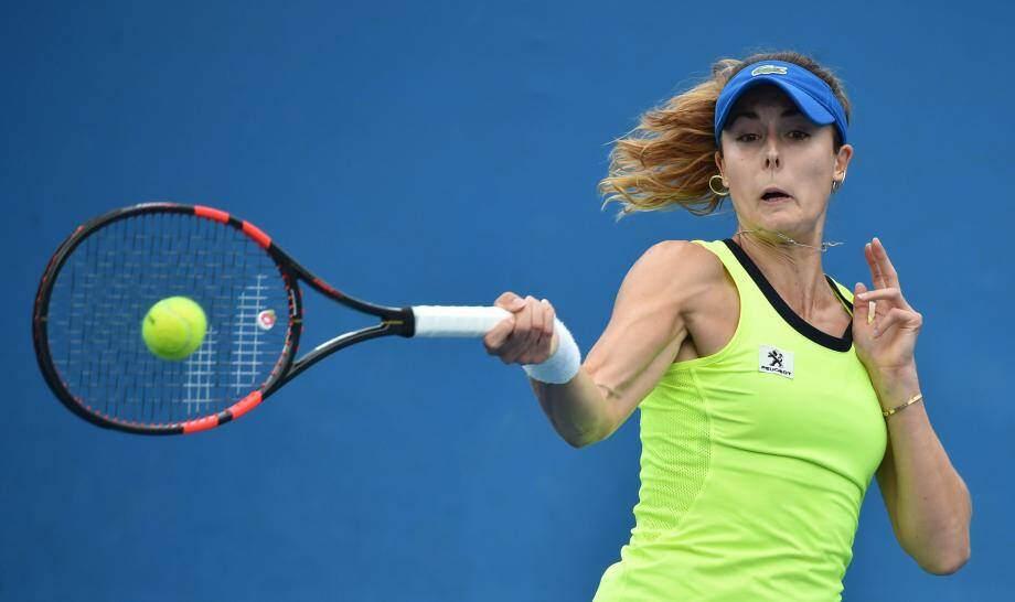 France's Alize Cornet plays a forehand return during her women's singles match against Serbia's Bojana Jovanovski on day two of the 2016 Australian Open tennis tournament in Melbourne on January 19, 2016. AFP PHOTO / PETER PARKS-- IMAGE RESTRICTED TO EDITORIAL USE - STRICTLY NO COMMERCIAL USE TENNIS-AUS-OPEN