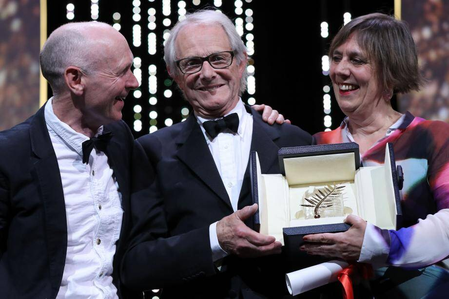 British director Ken Loach (C) celebrates on stage with British screenwriter Paul Laverty (L) and British producer Rebecca O'Brien after being awarded with the Palme d'Or for the film