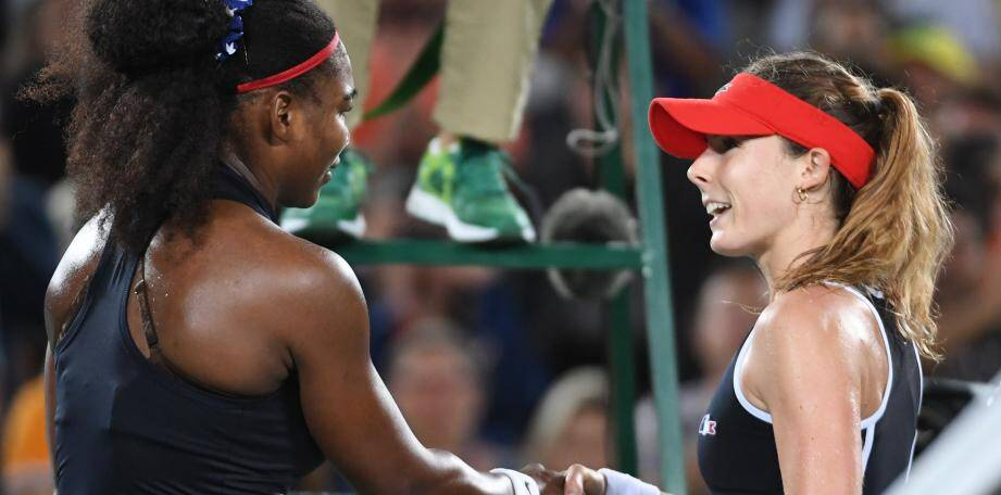 USA's Serena Williams (L) with France's Alize Cornet after winning their women's second round singles tennis match at the Olympic Tennis Centre of the Rio 2016 Olympic Games in Rio de Janeiro on August 8, 2016. / AFP PHOTO / Roberto SCHMIDT