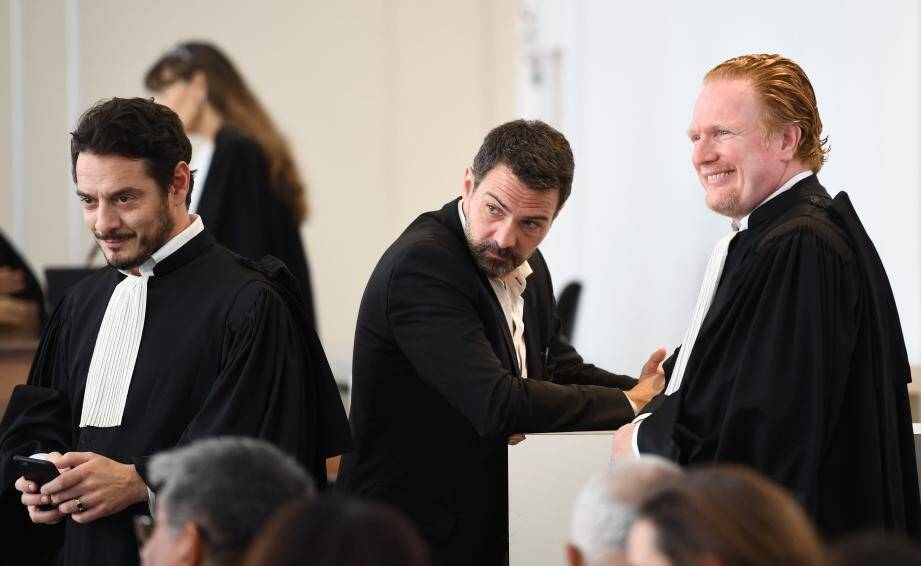 """French """"rogue trader"""" Jerome Kerviel (C), flanked by his lawyers David Koubbi (L) and Benoit Pruvost (R), attends his appeal trial at Versailles courthouse, outside Paris, on September 23, 2016.Kerviel was ordered on September 23 to pay 1.0 million euros ($1.12 million) to his former employer Societe Generale, which lost 4.9 billion euros through his trades. The appeals court in Versailles said Kerviel, 39, was """"partially responsible for the loss"""", which brought the French banking giant to the brink of bankruptcy in 2008. / AFP PHOTO / Martin BUREAU FRANCE-BAMKING-FRAUD-TRIAL-KERVIEL"""