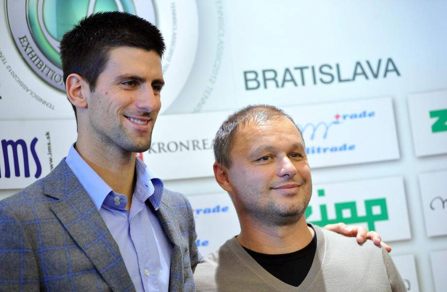 Djokovic et son ex-coach, Marian Vajda. (AFP)