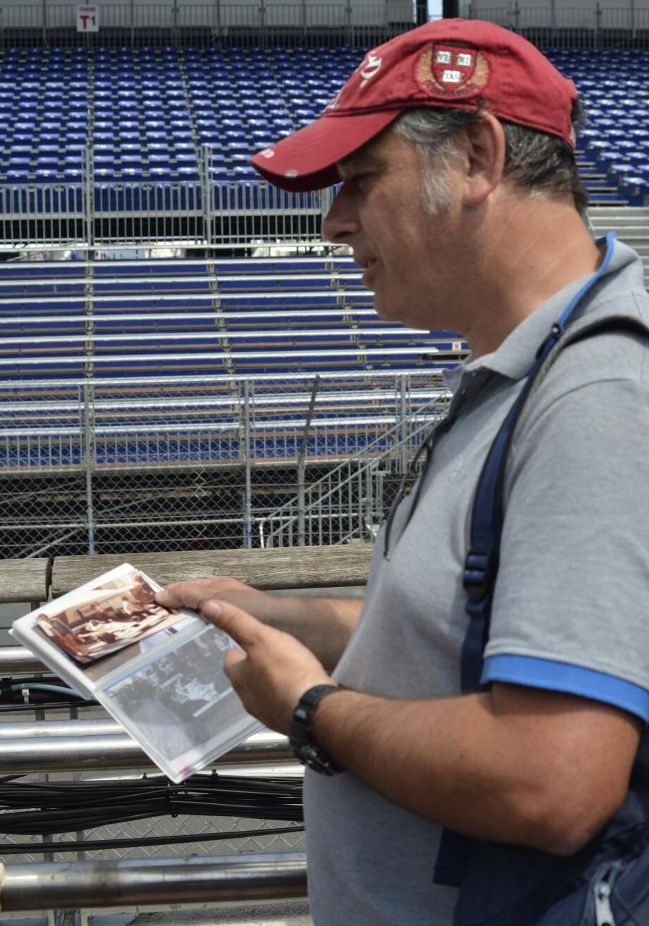 Le passionné de F1 et son carnet de photos du Grand Prix.