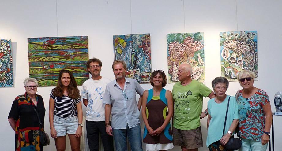 Christophe Gol (au centre) lors du vernissage.