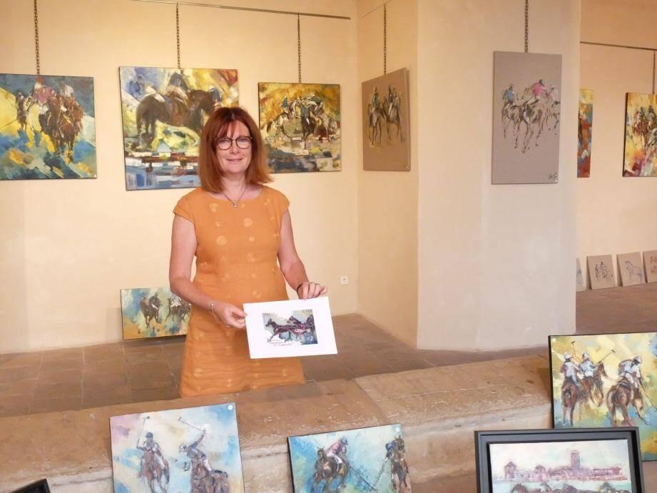 Anne Clabaux parmi quelques œuvres, avec le tableau qui a servi de thème au timbre sur Rambouillet.