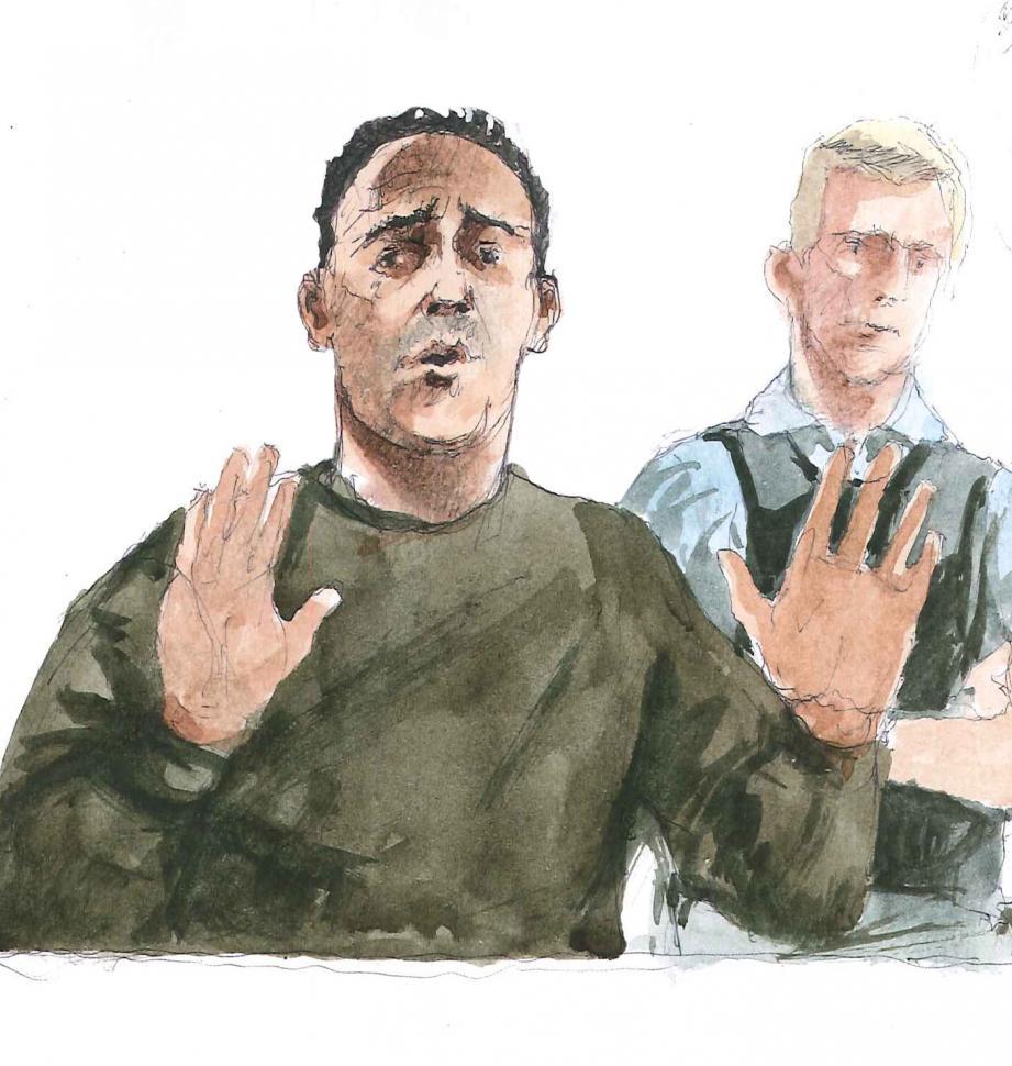 Dans le box, Stéphane Peduzzi s'exprime en faisant de grands gestes, les mains tremblantes, bien qu'il soit sous calmants.