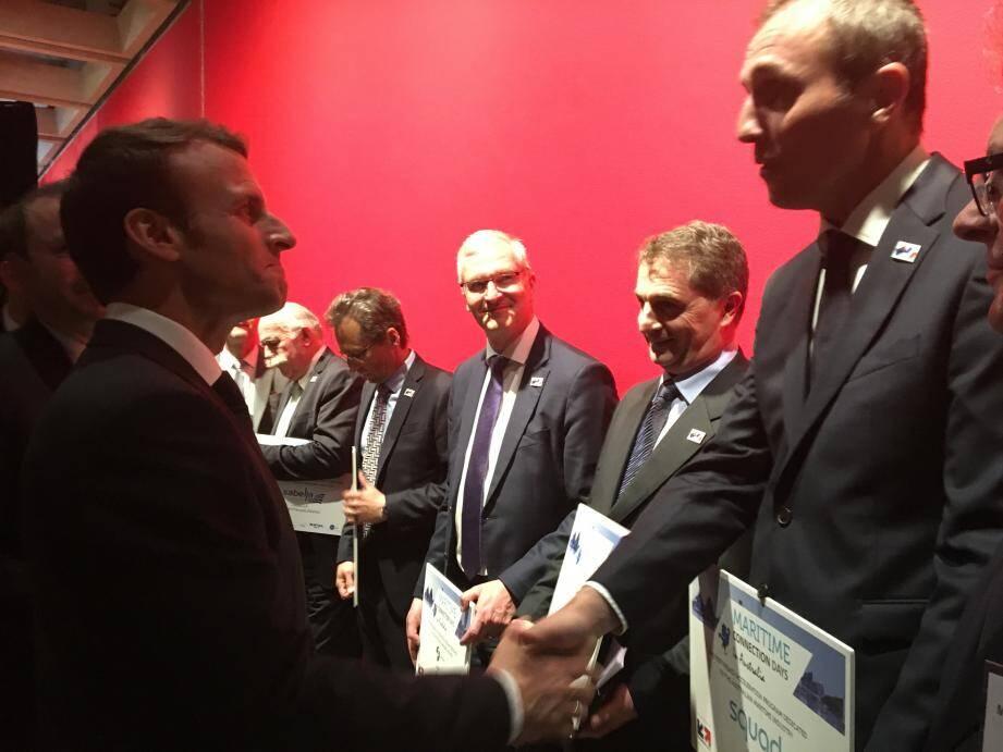 Le président Macron et le directeur général de Squad à l'occasion du déplacement en Australie.(D.R.)