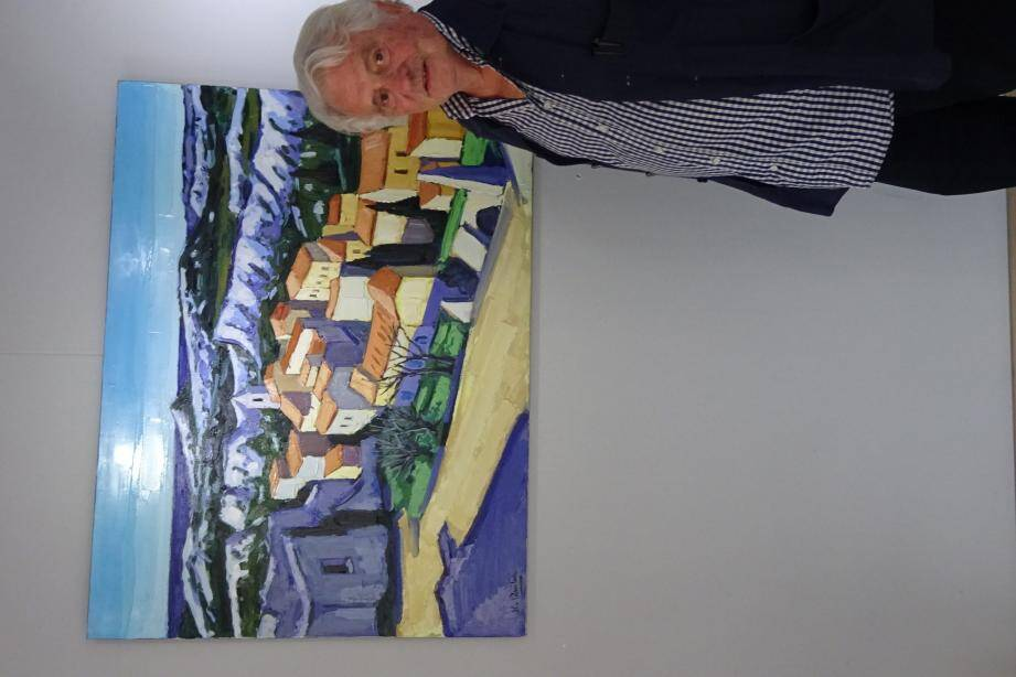 Jean-Claude Quilici devant une de ses œuvres : un village du Mont Ventoux.