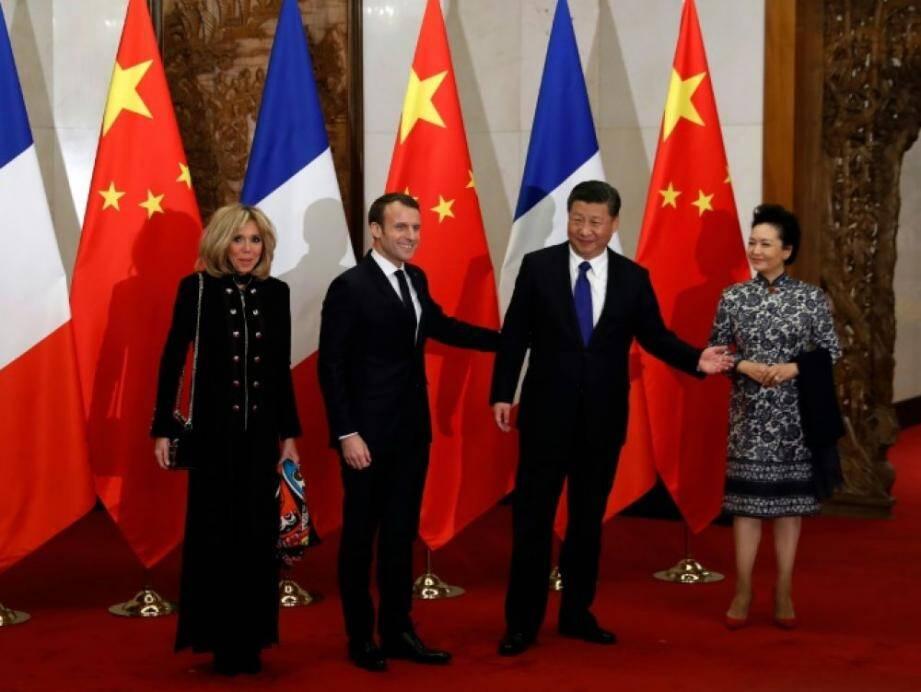 Emmanuel et Brigitte Macron rencontrent Xi Jinping et son épouse Peng Liyuan, à Pékin, le 8 janvier 2018.