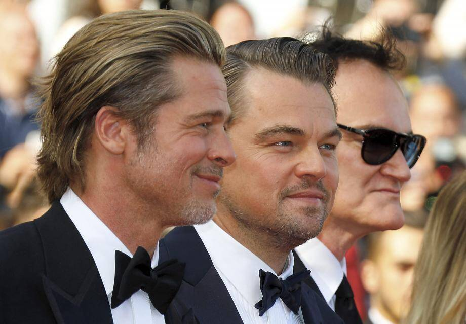 Brad Pitt, Leonardo DiCaprio et Quentin Tarantino lors de la montée des marches.