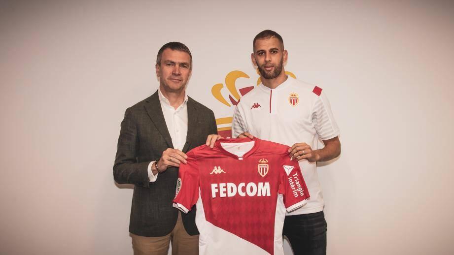 Oleg Petrov, vice-président du club, avec Islam Slimani.