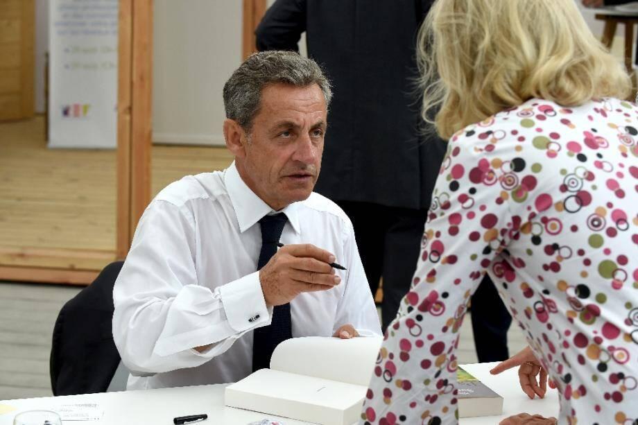 """L'ancien président Nicolas Sarkozy signe son livre """"Passions"""", le 29 août 2019 à Paris"""