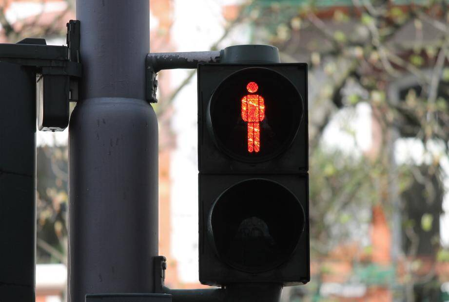 Un feu de signalisation pour les piétons. Illustration.