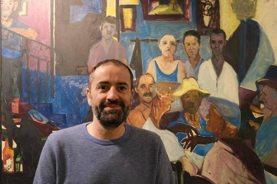 Stéphane Palmi au côté de son grand-père peint en haut à droite