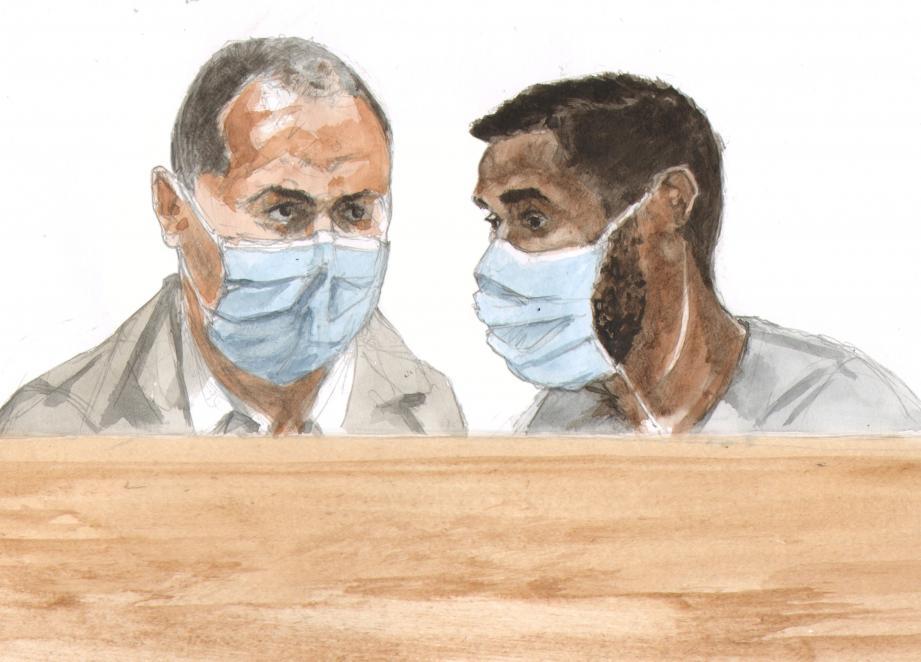 L'accusé (à droite) face à son interprète dans le box.(Croquis d'audience Rémi Kerfridin)