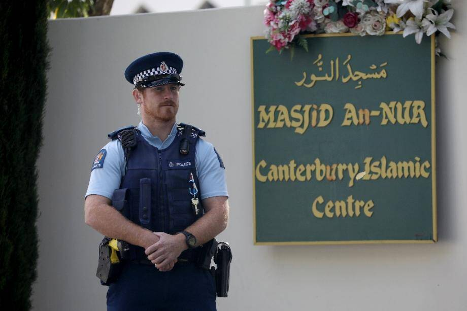 A police officer stands guard outside the Al Noor mosque ahead of the first anniversary of the Christchurch mosque shootings in Christchurch in March 2020