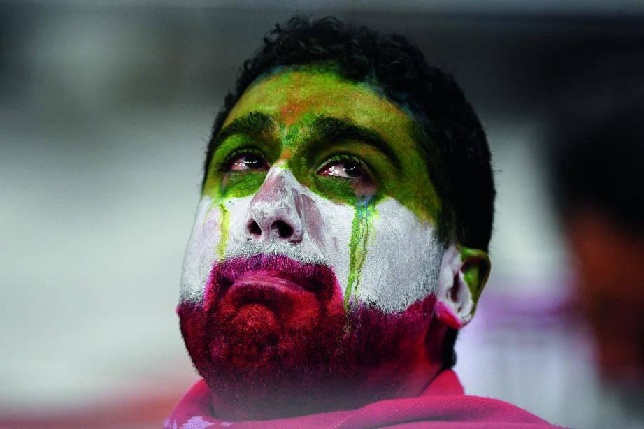 Un supporter en larmes après le match entre l'Iran et le Portugal pendant la Coupe du monde 2018