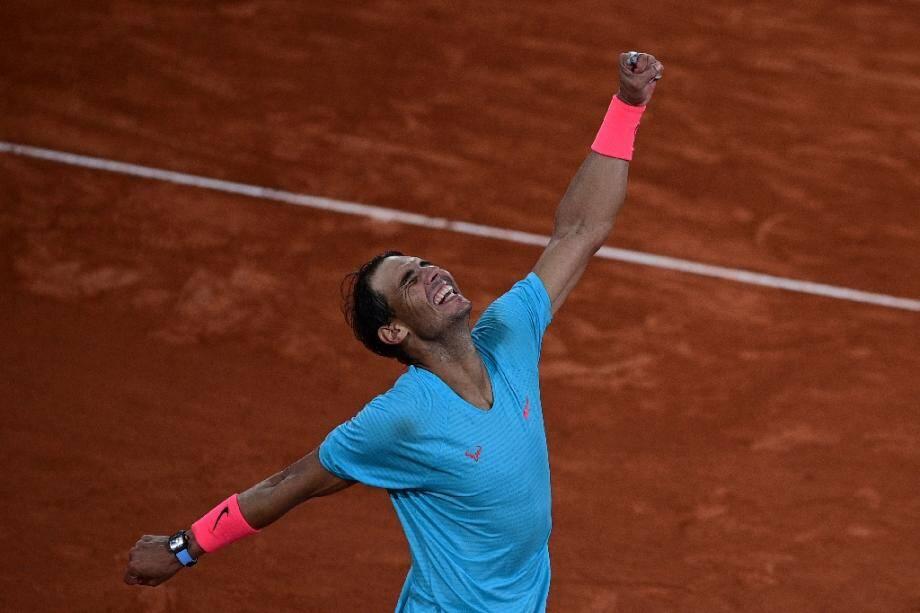 L'Espagnol Rafael Nadal jubile après sa victoire sur le Serbe Novak Djokovic en finale de Roland-Garros, le 11 octobre 2020
