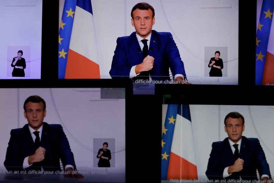 This screen grab made on November 24, 2020 shows French President Emmanuel Macron speaking during a televised address to the Nation on the Covid-19 pandemic and lockdown measures in France as the second virus wave reached its peak last week, French health authorities said, with numbers of new infections, new hospital admissions and new intensive care patients all declining, while death figures have stabilised. (Photo by THOMAS COEX / AFP)