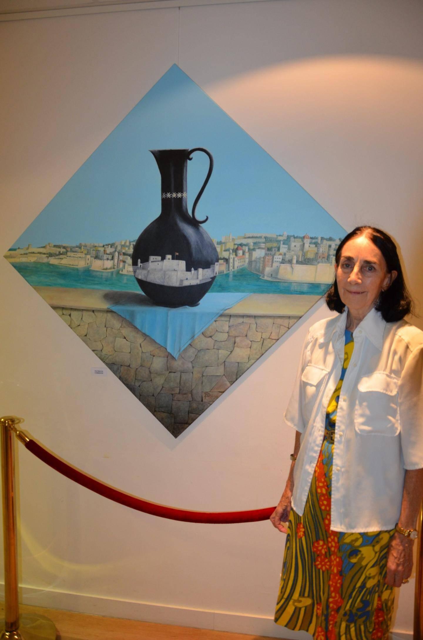 Devant son œuvre, magnifique, Patricia Cerrone, résidente monégasque, élève de longue date de Jean-Charles Grassi.