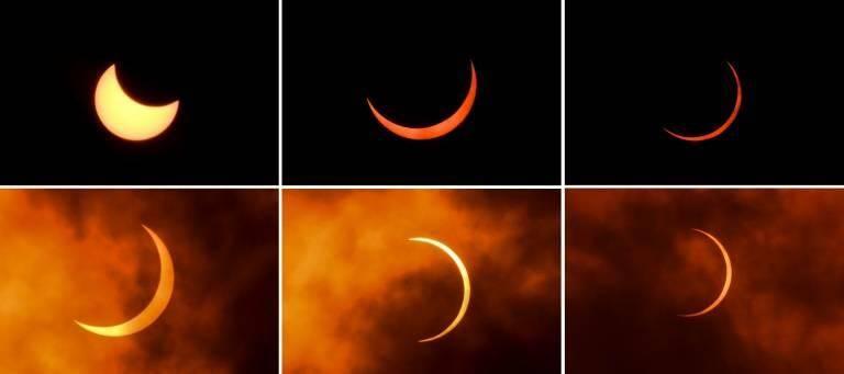 Cette combinaison de photos montre la Lune se déplaçant devant le Soleil, lors d'une éclipse annulaire, au moment du solstice d'été, observée à New Delhi le 21 juin 2020.