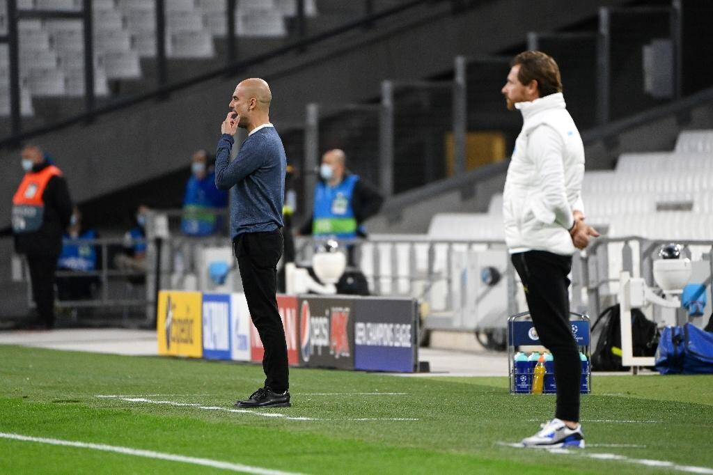 Le coach de Manchester City Pep Guardiola et celui de Marseille, André Villas-Boas, lors du match entre les deux clubs en Ligue des champions, le 27 octobre 2020 au Stade vélodrome