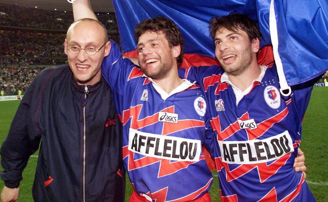 Bernard Laporte, Franck Comba et Christophe Dominici, le 16 mai 1998 au Stade de France après la victoire en finale du Stade français - CASG face à Perpignan.