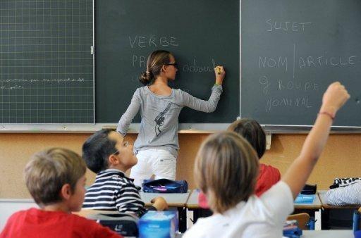 """Des élèves dans une école, le 5 septembre 2011 à Nantes - Photo de Frank Perry - AFP/Archives © 2013 AFP<a href=""""# """" rel=""""popup_name"""" class=""""poplight""""><img src=""""http://www.air-cosmos.com/img/1-1377-9999x22-0/logo-afp.jpg"""" alt=""""afp logo"""" title=""""afp logo""""  style=""""height:16px; width:37px; border:none; display: inline; margin-left: 5px; vertical-align:middle;"""" /></a>"""