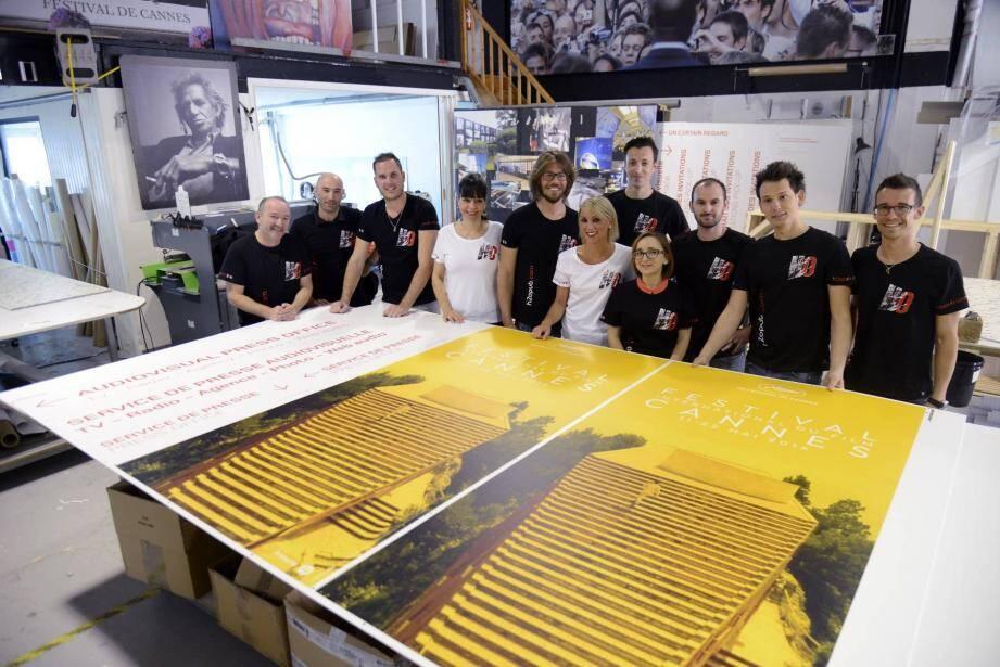 Jean-Mi, Marc et Fred Soulière sont absents de la photographie dans l'atelier du Cannet mais l'esprit de famille est là. Devant eux, l'affiche du Festival 2016 qui vient de sortir des presses.