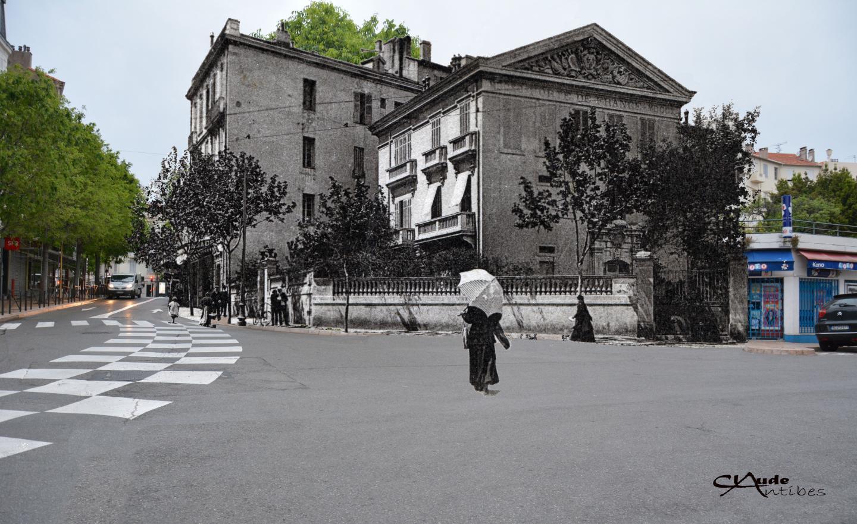 Porte de France, début XXe. Une bien belle époque que celle des ombrelles à agiter sous les fenêtres. C'est qu'on les verrait presque devant les commerces de la rue de la République…