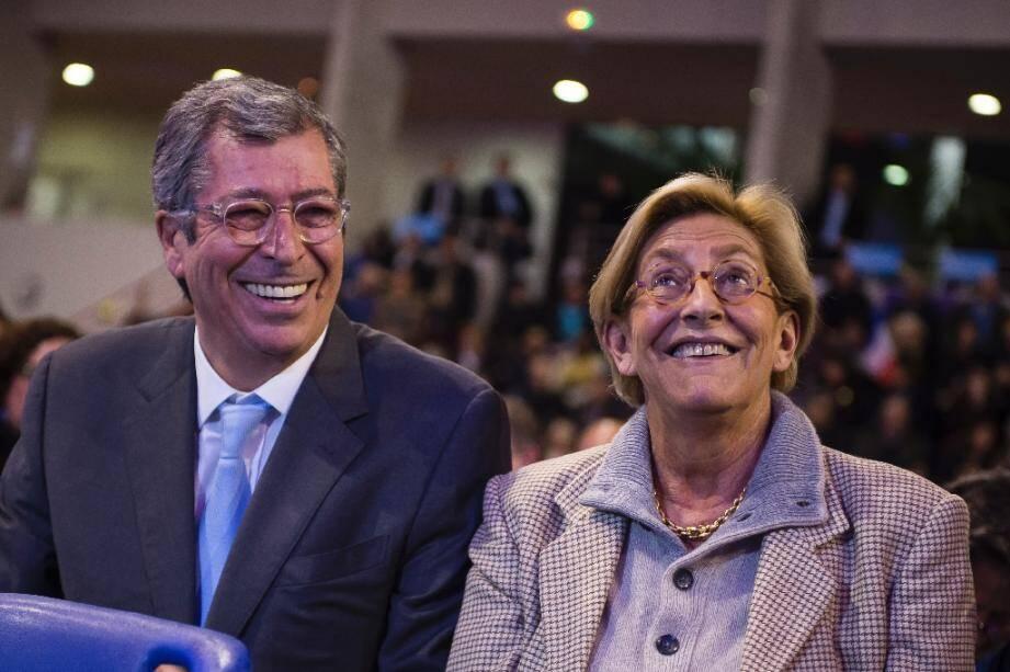 En près de 40 ans à la tête de Levallois, le couple Balkany (ici lors d'un meeting de campagne de LR le 3 décembre 2015) s'est assuré le soutien infaillible d'électeurs, au prix d'un endettement colossal