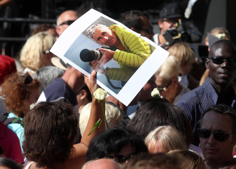 Le portrait du guide de haute-montagne brandi lors d'une marche hommage à Nice, le 27 septembre 2014.
